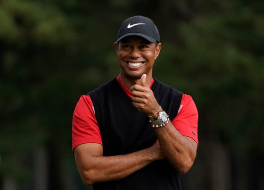 Tiger Woods gestures during the winner's ceremony after winning the Zozo Championship on Sunday.