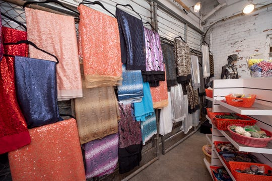 Shimmering fabrics hang in the showroom at the Detroit Fabric Company in Detroit.