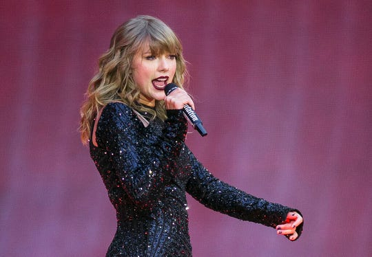In this June 22, 2018, file photo, singer Taylor Swift performs on stage in concert at Wembley Stadium in London. A 27-year-old Austin, Texas, man has pleaded guilty to stalking and sending threatening letters and emails to pop star Taylor Swift's former record label.