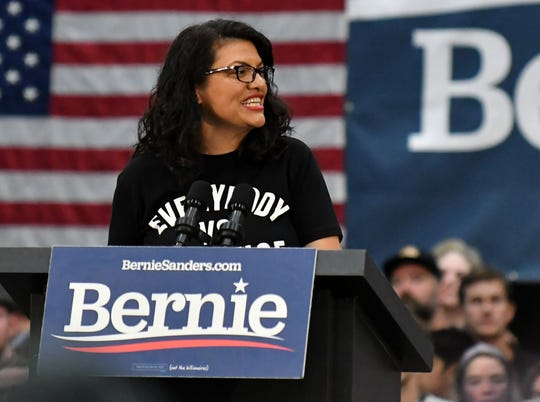 U.S. Rep. Rashida Tlaib speaks to a crowd of 4,700 at the Rashida Tlaib and Bernie Sanders rally at Cass Tech High School in Detroit on Oct. 27, 2019.  