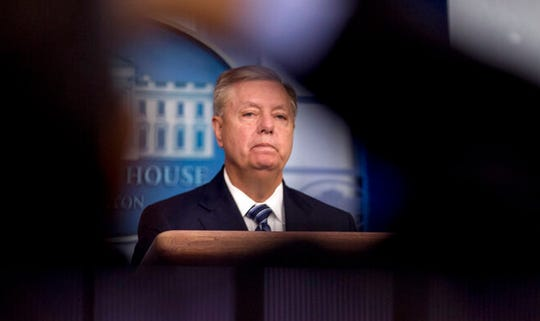 Sen. Lindsey Graham, R-S.C., takes a question from a reporter in the Briefing Room of the White House in Washington, Sunday, Oct. 27, 2019.