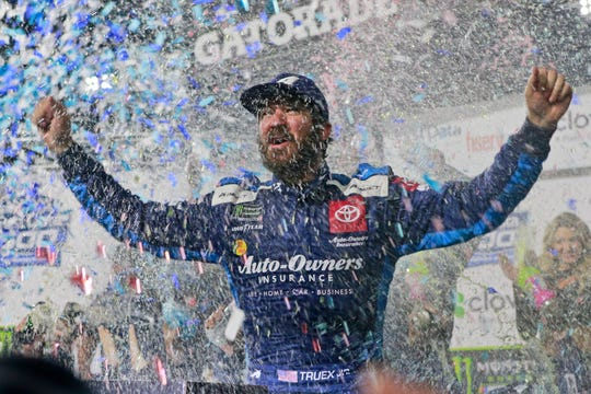 Martin Truex Jr. celebrates after winning the NASCAR Cup Series race at Martinsville Speedway on Sunday.