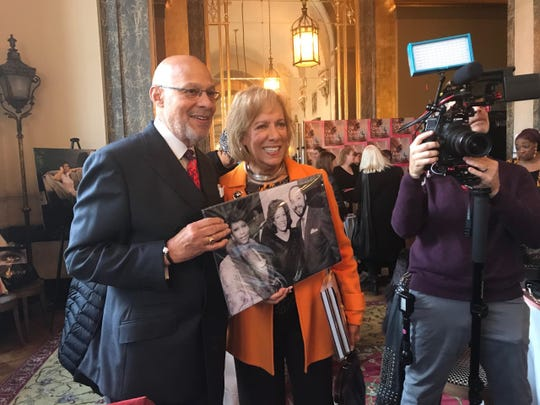 Former Mayor Dennis Archer and Trudy Archer with a Linda Solomon photo of them with Aretha Franklin.