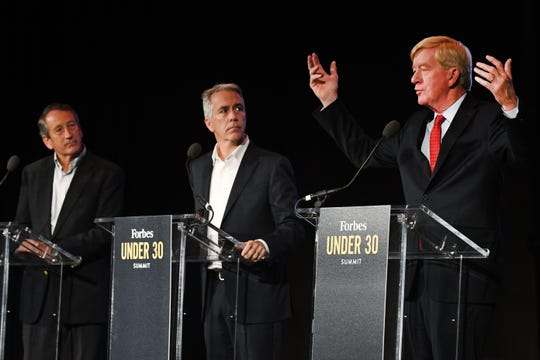 Republican presidential candidates, from left, former South Carolina governor and U.S. Rep. Mark Sanford and ex-U.S. Rep. Joe Walsh listen to former Massachusetts Gov. Bill Weld speak during a debate at the Forbes Under 30 Summit at Masonic Temple in Detroit, Monday (Oct. 28, 20190.