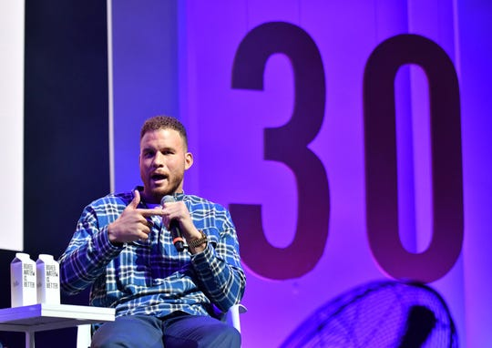 Randall Lane, Chief Content Officer and 30 Under 30 Founder, Forbes Media, out of frame, has a conversation with Pistons power forward Blake Griffin, shown here, at the Forbes Under 30 Summit at the Masonic Temple in Detroit on Oct. 27, 2019.