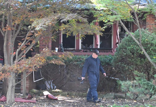 Fire personnel work the scene of a fire that killed two boys at a home on the 700 block of Fisher in Grosse Pointe on Monday.