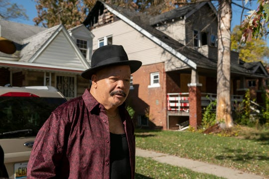 Julius Gailliard Jr. stands in front of his home on Derby in Detroit, Monday.