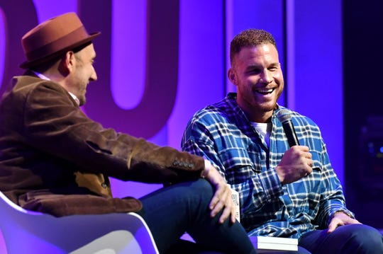 Randall Lane, left, chief content officer and 30 Under 30 founder at Forbes Media, talks to Pistons power forward Blake Griffin at the Forbes summit at the Masonic Temple on Sunday.