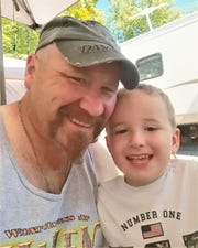 Quincey Root of Sayre and his son Jamison in happier times. Quincey Root was killed in a motorcycle crash this year, five years after his wife died of cancer.
