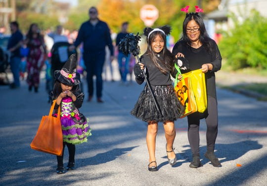 Leticia Garcia of Henderson, right, takes her daughters Melanie Garcia, 11, center, and Camila Garcia, 4, trick or treating at the Community Trunk or Treat Halloween Extravaganza in Henderson Sunday afternoon.