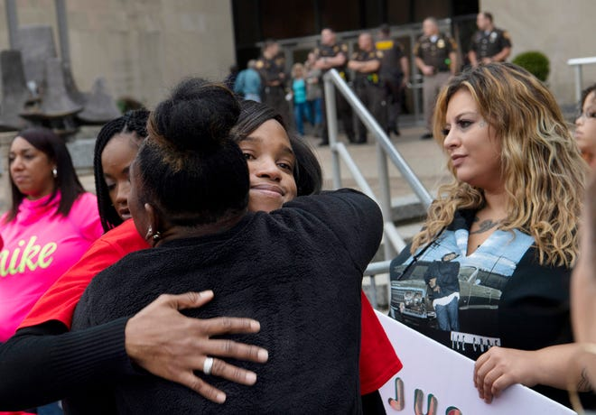 "Kelly Jo Marshall, center, of Evansville receives a hug at the conclusion of the ""Justice 4 Eli Rally"" outside the Civic Center in Evansville Monday afternoon. More than 50 people showed up to support Marshall who was unhappy with the decision to drop the charges against a man who allegedly sexually assaulted her young son."