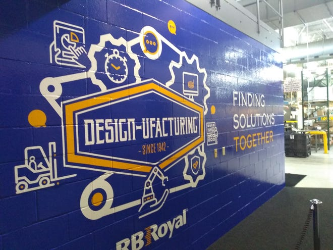 RB Royal employees can find the company's branding message throughout the building. On Friday, Oct. 25, the company installed the mural on the wall leading into the shop.