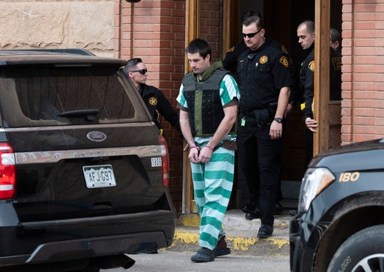 In this April 5, 2019, file photo, Teller County Sheriff deputies lead Patrick Frazee out of the Teller County Courthouse in Cripple Creek. The trial of Frazee, charged with killing his fiancee and burning her body, is getting underway.