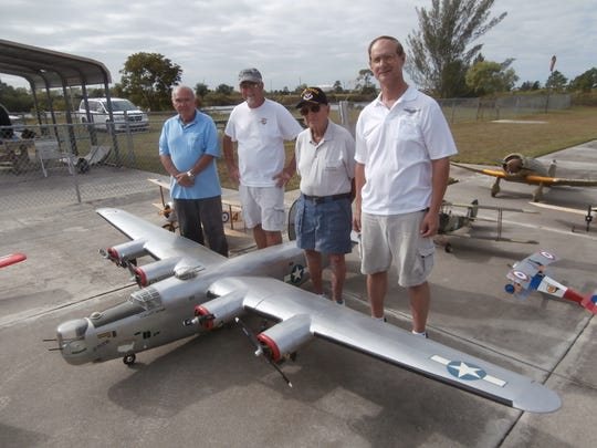 Cape Coral R/Seahawks Flying Club members Vice President Joe Dolliver, Mike Wolvin, Sidney Harris and President Joe Fannon gather behind Wolvin's B-24 Liberator bomber's 14-foot wingspan at Seahawk Park where it'll take flight during the War Birds Over Cape Coral air show on Nov. 9.