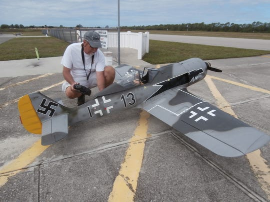 Cape Coral R/Seahawks Flying Club member Mike Wolvin does final checks before sending his German Focke-Wulf 190 fighter plane airborne at Seahawk Park.