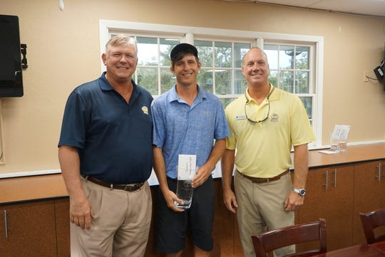 Airik Medinis, center, was crowned men's winner. He's pictured with Allen Manguson and Bob Jedlicka of Coral Oaks.