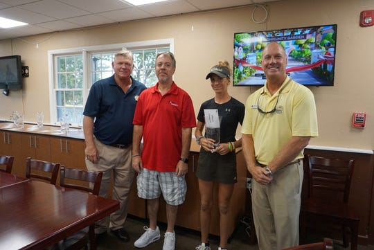 Jordan Fischer won the women's title with a tournament best 70-70-140. She's pictured with tournament director Allen Manguson, a Storm Smart official,  and assistant pro Bob Jedlicka.