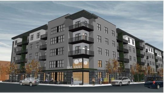 A rendering of a $21 million apartment building as seen from North Broadway and Kellogg Street. The building would feature first-floor retail space, 225 apartments and a rooftop deck.