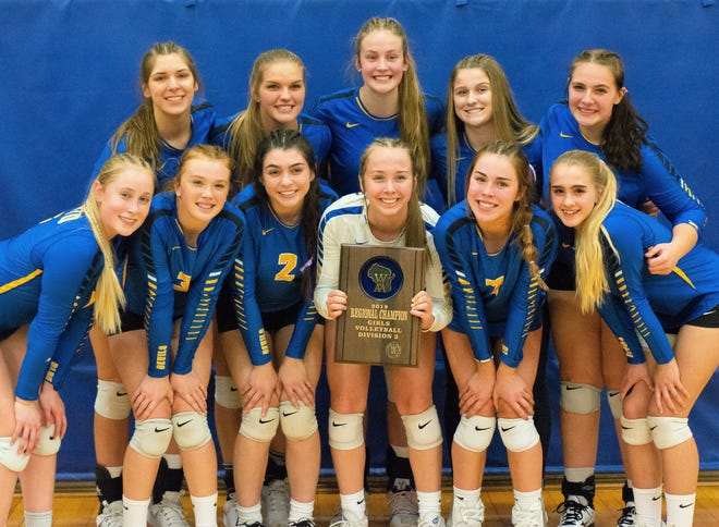The Oconto volleyball team poses with their regional title plaque after defeating St. Mary Catholic on Saturday. From left, front: Emma Walkowiak, McKenna Seidl, Juliana Sieber, Aubree Bucheger, Kate Bahrke, Leah Allan; back row: Hannah Moe, Jenna Hornblad, Cora Behnke, Maggie Sohrweide, Hailie McDonell.