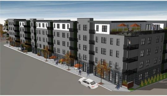 A rendering of a 225-unit apartment building proposed for the northeast corner of Broadway and Kellogg Street.