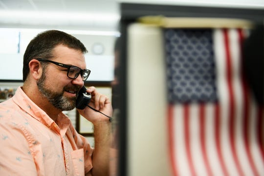 Michael Haring talks on the phone while working at the U.S. Department of the Interior in Denver, Colorado.