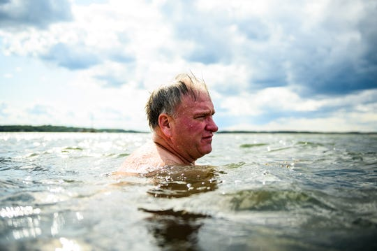 Dan Meehan, a Navy Reserve veteran, swims at the Fourth Cliff Family Recreation Area in Massachusetts in August. He is one of thousands of veterans ensnared by what authorities are calling a nationwide Ponzi scheme.