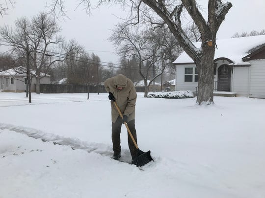 "John Rooney, a retired meteorologist, shovels his walk on Central Avenue Monday. ""We like the weather in Great Falls,"" he said."