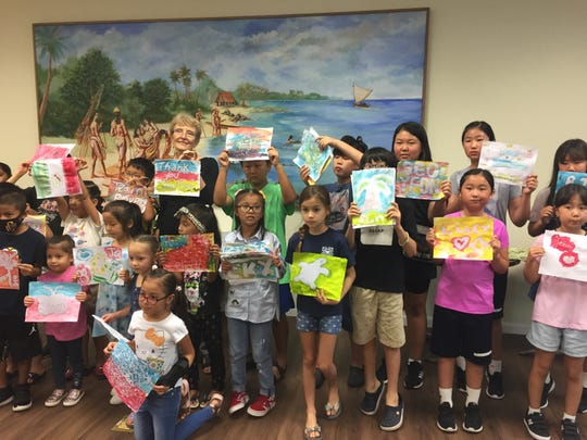 Judy Flores (pictured in back) held a batik class on Oct. 26 at the Guam Museum.  More than 25 children attended and created art.