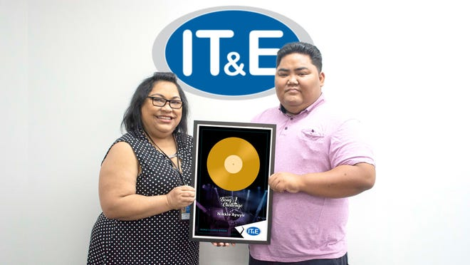 Nikkie Ayuyu won People's Choice in the IT&E Song Challenge. Pictured from left are Janice Tenorio, Customer Service Manager and Government Relations Manager at IT&E; and Ayuyu.