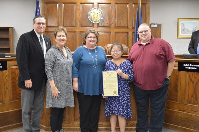 The October 2019 Judge's Scholar is Abigail White of Bend Gate Elementary.  Abigail is in the 5th Grade and is the daughter of Douglas and Allison White.  Shown here are, from left, are Henderson County Judge-executive Brad Schneider, Bend Gate Principal Deborah Harmon, Allison White, Abigail White and Douglas White.