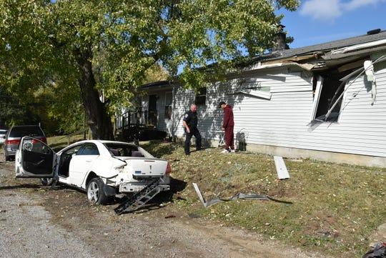 A car crash around noon ejected a woman on to the roof of a house.