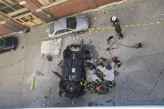 A vehicle fell from the 4th floor of a parking garage near City Market in Downtown Indianapolis on Wednesday, Oct. 23, 2019.