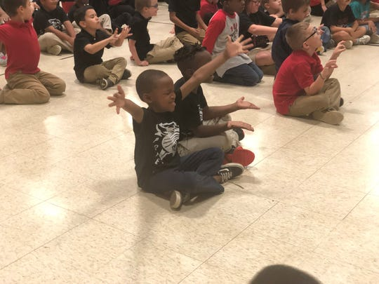 Pope Elementary first graders do a meditation-style routine during a GoNoodle video Friday.