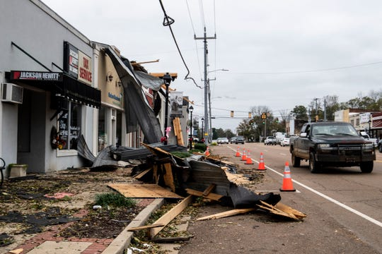 The Saturday storm affected Adamsville, Tenn., damaging many businesses, homes and landscapes in the area. The town is currently without electric and hot water. Many of the residents are attempting to clean up their homes, Monday, Oct. 28, 2019, by cutting down branches and burning them for heat.