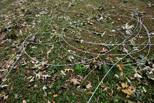 Powerlines are shown sitting on the grass after the Saturday storm affected Adamsville, Tenn., damaging many businesses, homes and landscapes in the area. The town is currently without electric and hot water. Many of the residents are attempting to clean up their homes, Monday, Oct. 28, 2019, by cutting down branches and burning them for heat.