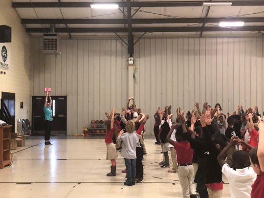 Pope Elementary first graders calm down to GoNoodle videos during an assembly Friday. BlueCare Tennessee partnered with GoNoodle — an interactive physical fitness and mindfulness program to get kids to move more.