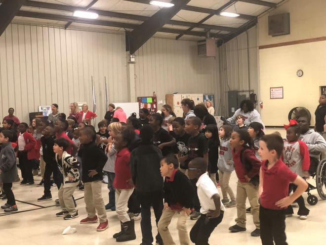 Pope Elementary first graders dance to GoNoodle videos during an assembly Friday. BlueCare Tennessee partnered with GoNoodle — an interactive physical fitness and mindfulness program to get kids to move more.