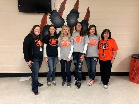 Powell staff modeling the Homecoming T-shirts are (from left) Kayla Cancemi, Hillary Limback, Angie Roberts, Melinda Lentz, Jennifer Morgan and Alice Carson.