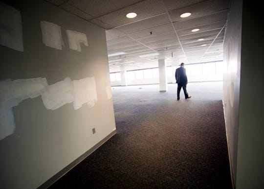 Knox County Mayor Glenn Jacobs walks around office space inside the TVA East Tower in downtown Knoxville on Monday, October 28, 2019.