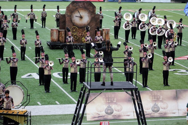 "Part of the ""Persistence of Time"" routine performed by the Lafayette Jeff Marching Bronchos."