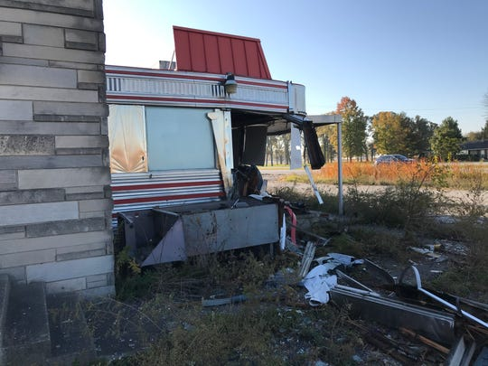 A corner of the stainless steel facade of a diner built in the early-'50s was taken out Saturday, Oct. 26, 2019, after a driver was cut off while driving on U.S. 52. The diner, once known as the Duck In Diner among other names, has been vacant for much of the decade.  New owners from Frankfort plan to raze the building and build a gas station and convenience store in 2020.