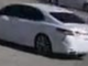 A suspect in a white Toyota Camry allegedly stole cash from a victim's vehicle after the victim withdrew the money from a nearby bank Oct. 22.