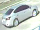 A suspect driving a silver Nissan was seen breaking into a vehicle after the vehicle had withdrawn cash from a bank.