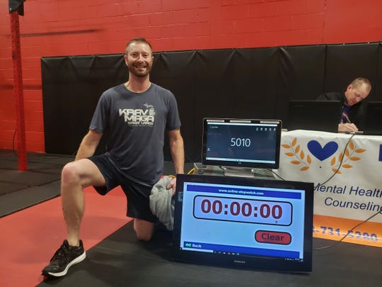 Krav Maga Great Lakes co-owner Mike Berean accomplished 5,010 chest to ground burpees in a 12-hour period Sunday, Oct. 27, 2019 at his Wixom self-defense and fitness studio. He is submitted his attempt to Guinness World Records.