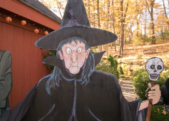 This witch was the first Halloween plywood cutout Leanne Szatkowski created about 30 years ago, and her collection of holiday-themed characters has grown over the years at her Parshallville Road home, shown Monday, Oct. 28, 2019.