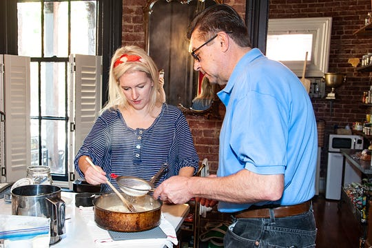 Food writer Dana McMahan and chef Guy Genoud of Brassiere Provence mix up the batter for the Panisse.