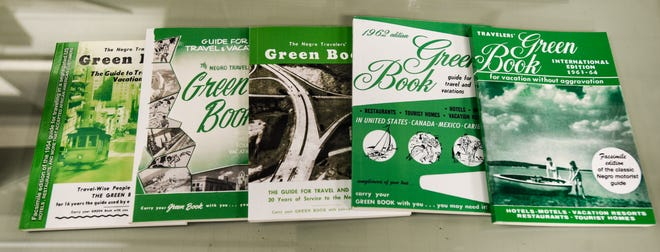 Five editions of The Negro Motorist Green Book seen on display at the MSU Library.  Some African Americans used these books during travel from the 1930s through the 1960s. The books featured businesses and homes that would serve black people.