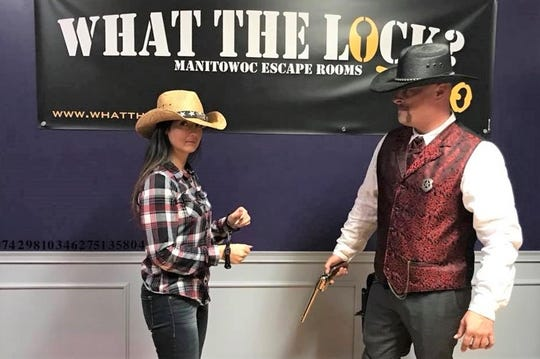 Tiffany and Kurt Duzeski, owners of What the Lock? escape rooms in downtown Manitowoc.