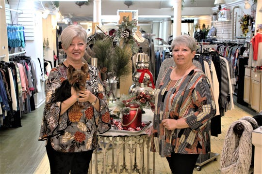 Brenda Gilliam, left, and Nadine Slone are the co-owners of Southern Accents Boutique located at Charleston Place in downtown Marion. The sisters have been in business together for about 30 years. Gilliam is holding Izzy, the store's official greeter and cuddler.