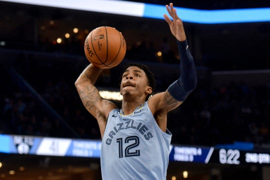 Memphis Grizzlies guard Ja Morant (12) goes up for a dunk in the first half of an NBA basketball game against the Brooklyn Nets, Sunday, Oct. 27, 2019, in Memphis, Tenn. (AP Photo/Brandon Dill)